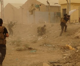 Iraqi security forces defend their headquarters against attacks by Islamic State extremists in the eastern part of Ramadi