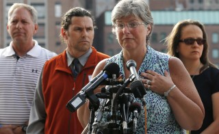 Boston Marathon bombing survivor Karen Brassard speaks to the news media in front of the federal courthouse in Boston