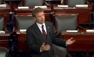 U.S. Senator Rand Paul delivers a speech on the floor of the U.S. Senate, in this still image taken from video, on Capitol Hill in Washington May 20, 2015. A crucial vote set for May 21, 2015 on legislation to help President Barack Obama complete a Pacific Rim trade deal was in doubt as senators struggled to defuse landmines ranging from currency manipulation rules to renewing the Export-Import Bank. Paul on Wednesday launched an hours-long speech against renewing the domestic surveillance program, and in the process interrupting the Senate's work on a fast-track trade bill. Photo by Senate TV/Handout via Reuters