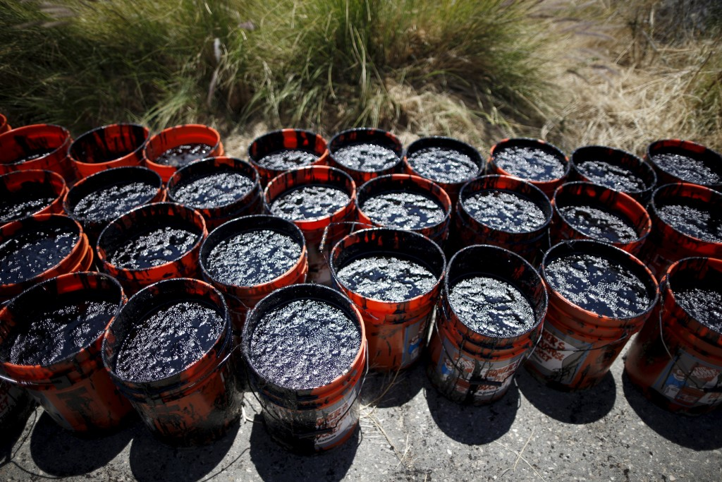 Buckets of oil volunteers carried from an oil slick along the coast of Refugio State Beach are seen in Goleta, California, United States, May 20, 2015. Photo by Lucy Nicholson/Reuters