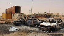 A view of vehicle wreckages after a suicide car bomber blew himself at a checkpoint near Mistrata