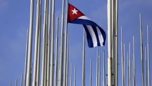 The Cuban flag flies in front of the U.S. Interests Section (background), in Havana