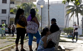 People wait to apply for visas outside the U.S. Interests Section in Havana, Cuba, on May 22. Photo by Enrique de la Osa/Reuters
