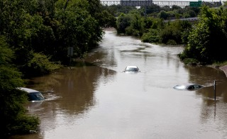 Flood waters cover several cars on the South I-610 frontage road in Houston, Texas on May 26, 2015. Photo by Daniel Kramer/Reuters