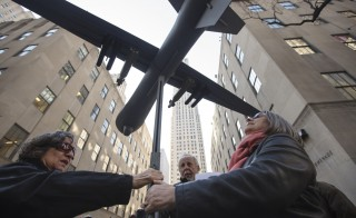 "Members of the group ""Grandmothers Against the War"" adjust a model of a drone during a protest against the use of drone strikes by the U.S. government in New York on April 3, 2013.  Photo by Lucas Jackson/Reuters"