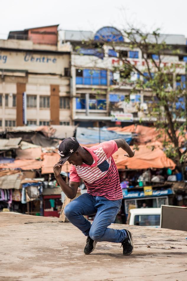 A b-boy poses in Uganda. Image courtesy of BOND/360.
