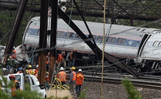 Rescuers work around derailed carriages of an Amtrak train in Philadelphia on May 13. Photo by Jewel Samad/AFP/Getty Images