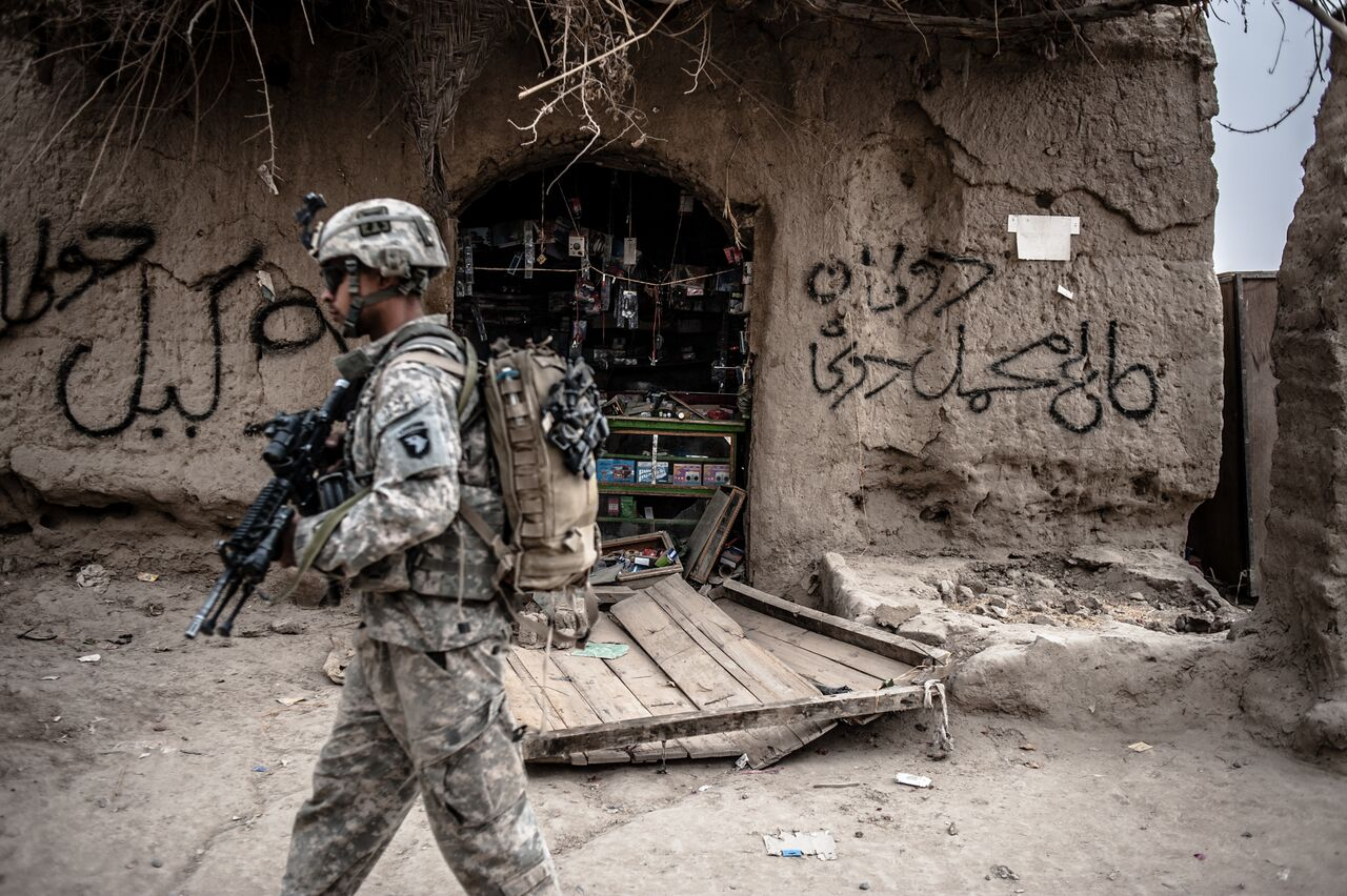 A U.S. patrol passes through Talukan's bazaar in Panjwayi District in Kandahar. Stores were looted the previous night. Photo by Ben Brody/The GroundTruth Project