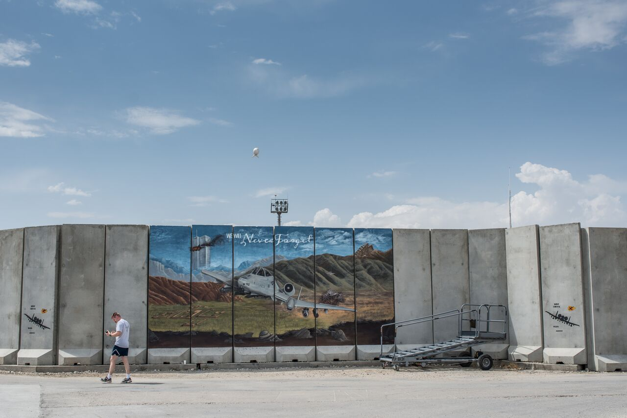At Bagram Airfield, a mural on a blast wall connects the 9/11 terrorist attacks on the United States to the fight in Afghanistan. Photo by Ben Brody/The GroundTruth Project