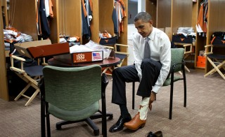 Texas, Aug. 9, 2010. Trying on a pair of cowboy boots at the University of Texas in Austin. Photo by Pete Souza/White House
