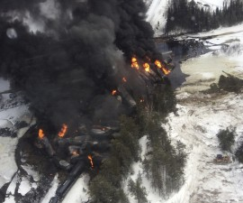 Handout photo of smoke rising from fires caused by the derailment of a CN Railway train carrying crude oil near the northern Ontario community of Gogama