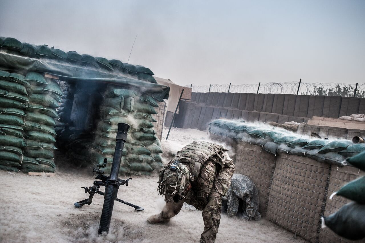 At Combat Outpost Sangsar in Kandahar, soldiers from the 10th Mountain Division fire mortar rounds at nearby Taliban positions. Soldiers faced regular attacks at the outpost. Photo by Ben Brody/The GroundTruth Project