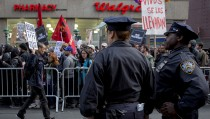 New York City Police officers (NYPD) watch as demonstrators calling for social, economic and racial justice march in New York