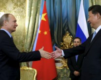 Russia's President Putin welcomes China's President Xi Jinping during their meeting at Kremlin in Moscow