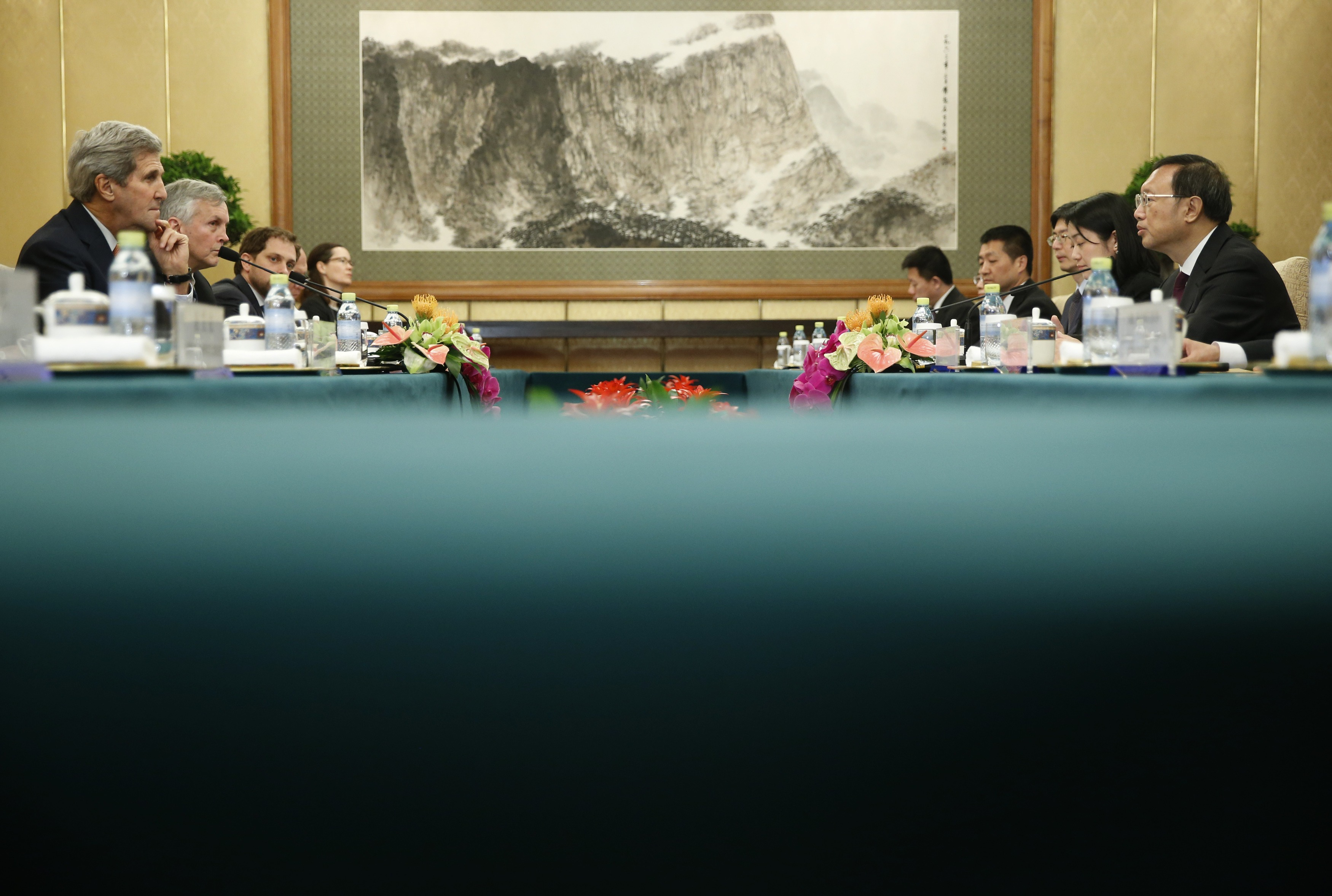 U.S. Secretary of State John Kerry (L) speaks with China's State Councilor Yang Jiechi at the Diaoyutai State Guest House on May 16, 2015 in Beijing, China. U.S. Secretary of State John Kerry is urging China to halt increasingly assertive actions it is taking in the South China Sea. Photo by Kim Kyung-Hoon - Pool/Getty Images.