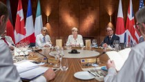 U.S. President Barack Obama, Germany's Chancellor Angela Merkel and France's President Francois Hollande (L-R) attend a working dinner at a G7 summit at the hotel castle Elmau in Kruen, Germany, June 7, 2015. Leaders from the Group of Seven (G7) industrial nations met on Sunday in the Bavarian Alps for a summit overshadowed by Greece's debt crisis and ongoing violence in Ukraine. Photo by Michael Kappeler/REUTERS