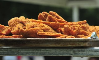 A plate sits full of crispy fried catfish. For years, generations of Turners have passed around similar platters during the family's annual reunion in Tupelo, Mississippi. Photo courtesy of Jimmy Smith/Flickr