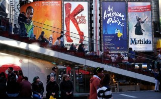 "A poster of the musical show ""An American in Paris"" is seen among with other shows at the Palace Theater in New York on April 12, 2015 during its debut. ""An American in Paris"" -- a modernized version of the 1951 Oscar-winning film, tells the romance between a beguiling French waitress and a former American soldier working to rebuild their lives after the horrors of World War II. AFP PHOTO/JEWEL SAMAD        (Photo credit should read JEWEL SAMAD/AFP/Getty Images)"