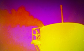 04-21-2015  A ohotograph of laptop computer screen showing a storage tank sprewing methane gas as seen from a Thermal camera imaging system operated by Andrew Thorpe of NASA's Jet Propulsion Laboratory next to a natural gas facility near Aztec, New Mexico identified by researchers in aircraft of leaking a significant amount of methane gas.