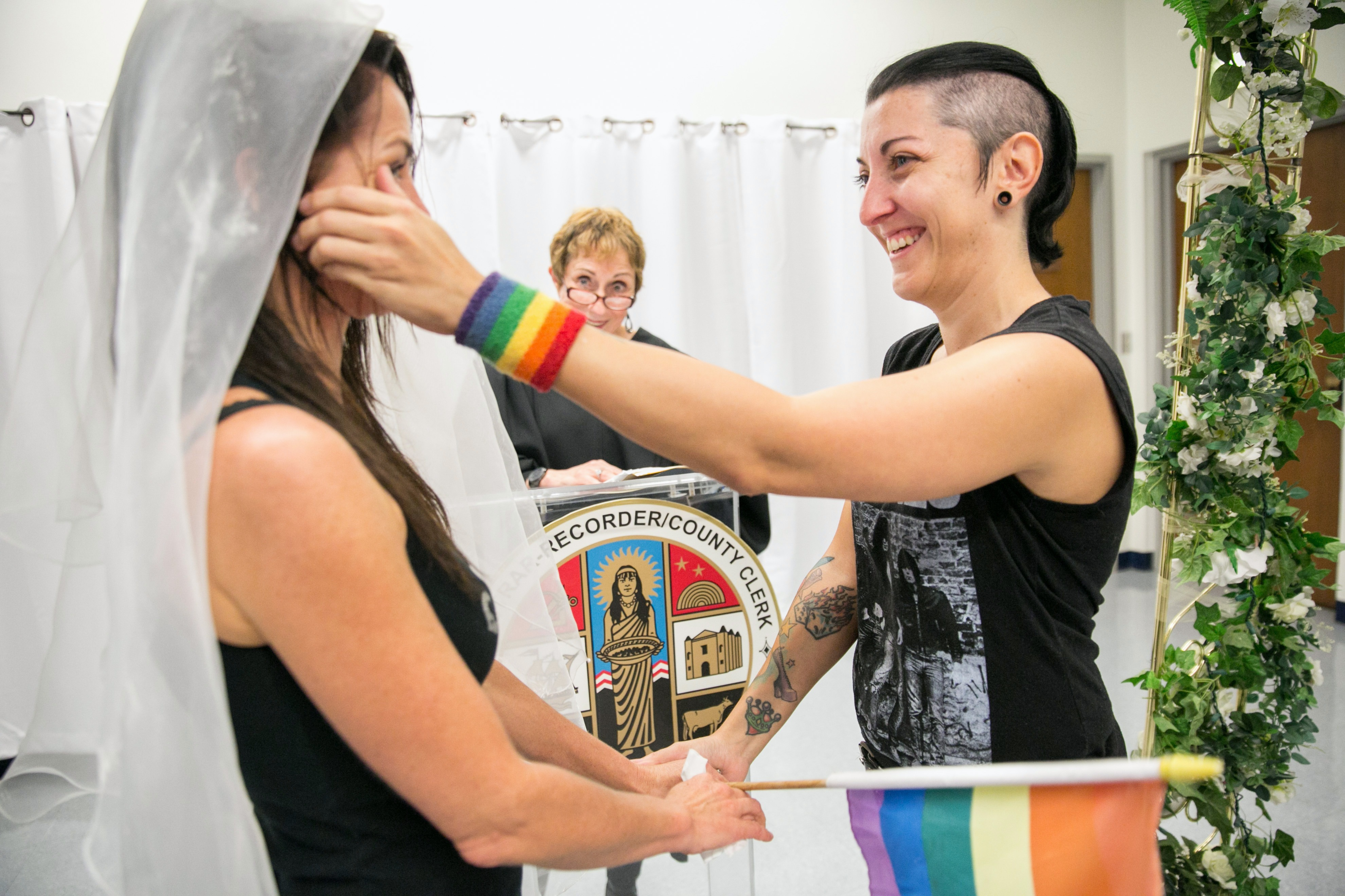 BEVERLY HILLS, CA - JUNE 26: Natalie Novoa (R) wipes the tears off her partner Eddie Daniels' cheeks during their wedding ceremony at the L.A. County Registrars office on June 26, 2015 in Beverly Hills, California. The couple have been together for the past 11 years and have been waiting to wed this auspicious day. In a landmark 5-4 decision, the U.S. Supreme Court ruled that same-sex couples have a constitutional right to marry in all 50 states. (Photo by Marcus Yam/Los Angeles Times via Getty Images)