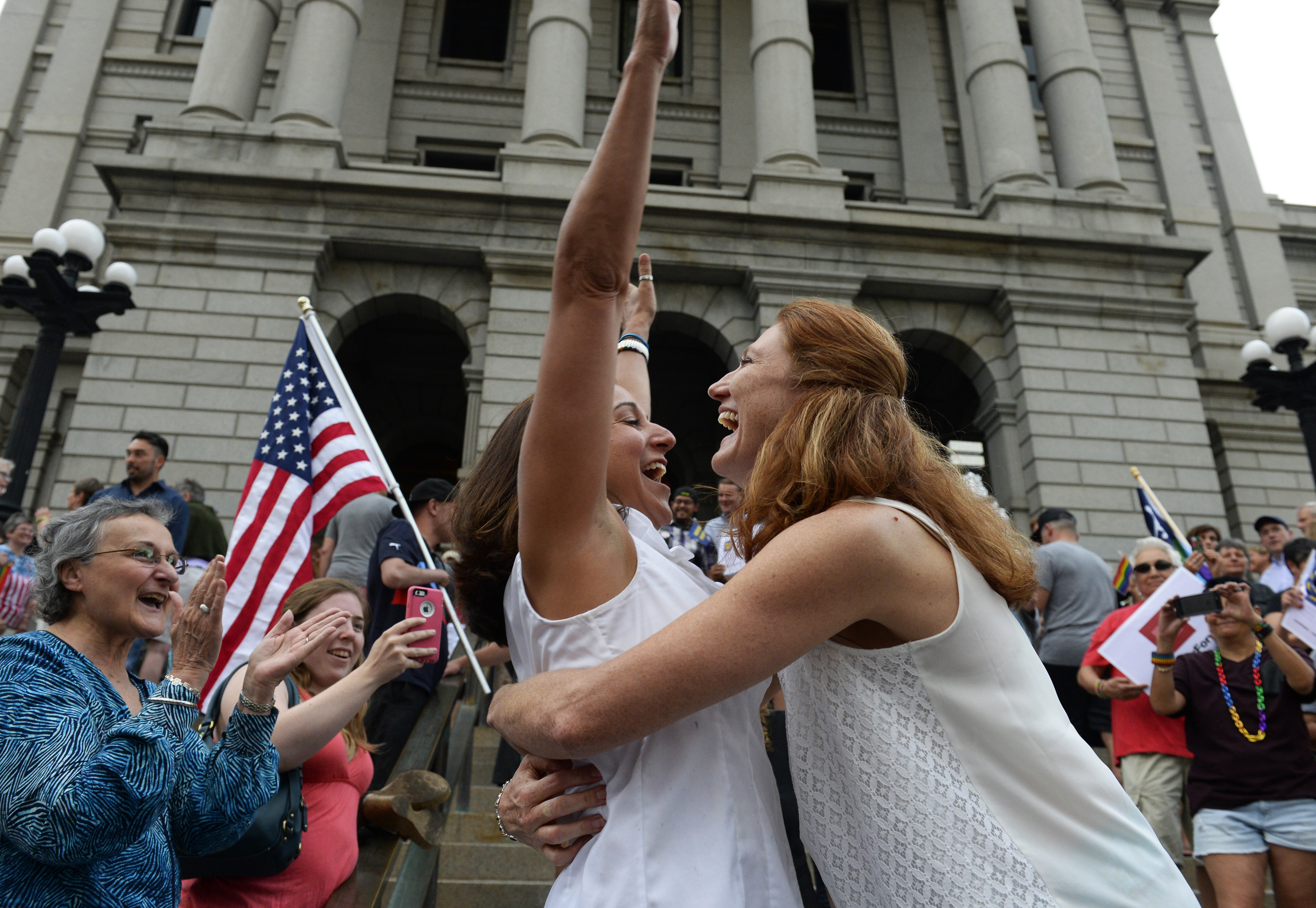 DENVER, CO - JUNE 26: Stephanie Santorico, left, and her wife, Diane Santorico celebrate moments after they married on the west steps of the Colorado State Capitol during a rally celebrating the Supreme Court's ruling giving same-sex couples the right to marry nationwide. June 26, 2015. (Photo by Andy Cross/The Denver Post)