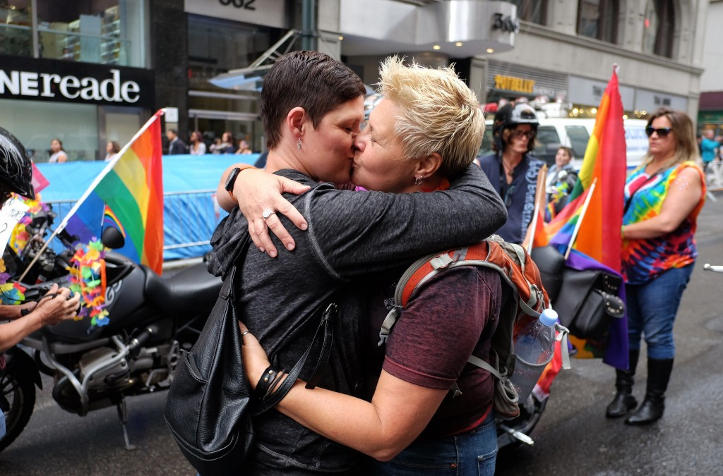A couple kisses before taking part in the 2015 New York City Pride parade in New York on June 28, 2015. Under a sea of rainbow flags, hundreds of thousands of jubilant supporters poured onto New York's streets for the annual Gay Pride March, two days after the US Supreme Court's landmark ruling to legalize gay marriage. AFP PHOTO/JEWEL SAMAD (Photo credit should read JEWEL SAMAD/AFP/Getty Images)