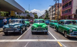 Classic cars stopped on a busy street in Havana. Photo by Frank Carlson