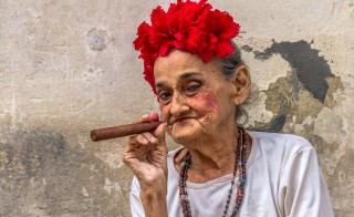 A woman poses with a cigar on a street in Old Havana. Photo by Frank Carlson