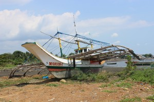 An abandoned fishing boat in Masinloc, Philippines. Photo by Tracy Wholf/NewsHour.
