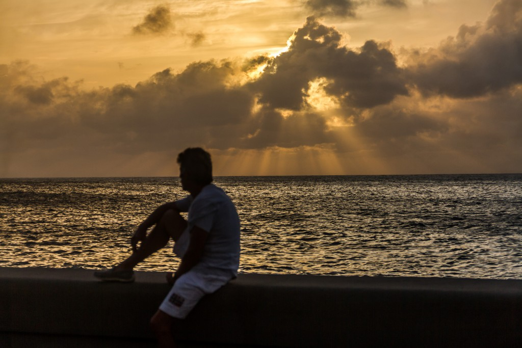 The sun sets on the Malecon, Havana's oceanfront promenade. Photo by Frank Carlson