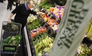 A shopper looks through the produce section in a newly opened Walmart Neighborhood Market in Chicago, September 21, 2011. The 27,000 square foot (2508 square meters) store is the first in Illinois with an emphasis on groceries and basic household goods. Photo by Jim Young/Reuters