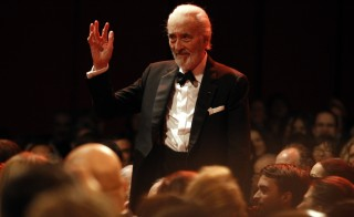 British actor Christopher Lee acknowledges the audience as he arrives for the screening of the movie 'Farewell My Queen'  ('Les adieux a la Reine') during the 62nd Berlinale International Film Festival in Berlin February 9, 2012. The legendary actor died at 93, his wife announced Thursday. Photo by Fabrizio Bensch/Reuters