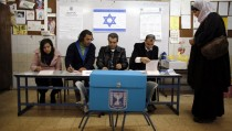 An Israeli-Arab woman arrives at a polling station to cast her ballot for the parliamentary election in the northern Druze-Arab village of Maghar January 22, 2013. Israelis voted on Tuesday in an election that is expected to see Prime Minister Benjamin Netanyahu win a third term in office, pushing the Jewish state further to the right, away from peace with the Palestinians and towards a showdown with Iran. REUTERS/Ammar Awad (ISRAEL - Tags: POLITICS ELECTIONS) - RTR3CSJU