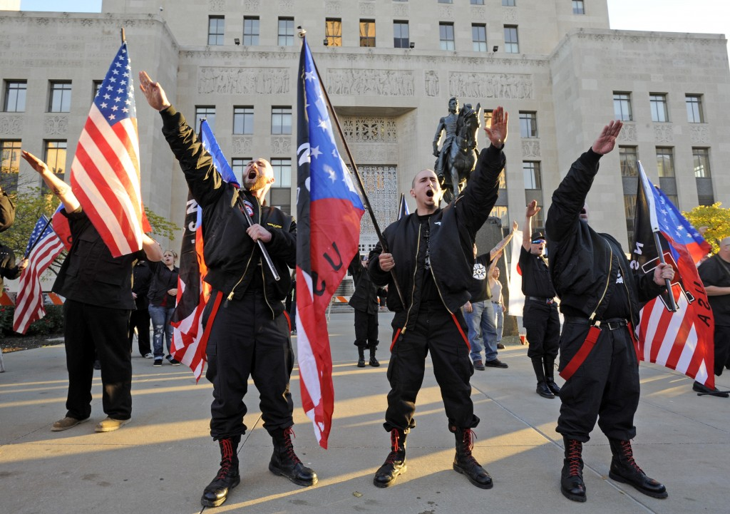 """Members of the National Socialist Movement """"salute"""" a speaker during a ..."""