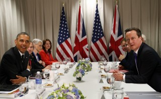 President Barack Obama (L) and British Prime Minister David Cameron (R) meet at the G-7 Summit in Brussels June 5, 2014.  None of the G-7 member states believes the punishments levied on Russia are changing President Vladimir Putin's calculus, yet there are no plans to shift strategies. Photo by Kevin Lamarque/Reuters