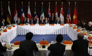 U.S. President Barack Obama meets with the leaders of the Trans-Pacific Partnership  countries. Negotiators said they reached a deal on the TPP on Monday. Photo by Kevin Lamarque/REUTERS