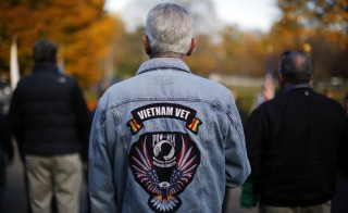 Vietnam War veteran Norm Polacke participates in Veterans Day ceremonies in Cambridge, Massachusetts November 11, 2014.        REUTERS/Brian Snyder    (UNITED STATES - Tags: MILITARY) - RTR4DR44
