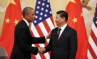 U.S. President Barack Obama (L) and China's Xi Jinping shake hands at the end of their news conference in the Great Hall of the People in Beijing November 12, 2014. The two country leaders will meet for annual talks in Washington next week. Photo by Kevin Lamarque/Reuters