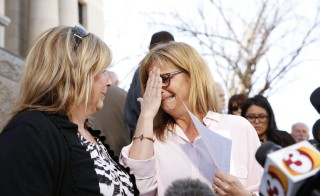 "Terri Crippes (L) and Lori Lyon, the aunts of Kayla Mueller, react after giving a statement at a news conference in Prescott February 10, 2015. President Barack Obama and the family of U.S. aid worker Mueller confirmed on Tuesday that the last-known American hostage held by Islamic State militants had died, with Obama promising to ""find and bring to justice the terrorists who are responsible."" U.S. officials said the family received an email and photograph over the weekend from her captors that confirmed her death but said the circumstances in which she died remained unclear. Nancy Wiechec/Reuters"