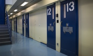 Jail cells are seen in the Enhanced Supervision Housing Unit at the Rikers Island Correctional facility in New York March 12, 2015. New York City is proposing to reduce violence among inmates at its troubled Rikers Island jail by limiting visitors, adding security cameras and separating rival gangs, Mayor Bill de Blasio announced on Thursday. REUTERS/Brendan McDermid (UNITED STATES - Tags: CRIME LAW CIVIL UNREST) - RTR4T5PM
