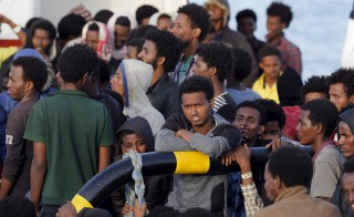 Migrants wait to disembark in the Sicilian harbour of Augusta, Italy, May 30, 2015. Italian efforts continue to rescue migrants from the Mediterranean, with 3,500 migrants rescued on Saturday, June 6, 2015, in collaboration with other European countries. Photo by Antonio Parrinello/Reuters