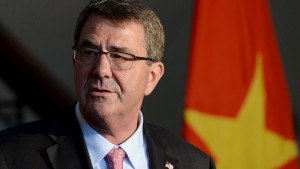 U.S. Defense Secretary Ash Carter speaks during a joint news conference with Vietnam's Defence Minister Phung Quang Thanh (not pictured) at the Defence Ministry in Hanoi June 1, 2015.  Carter discussed his call for an end to island-building in the South China Sea during talks on Monday with his Vietnamese counterpart, who told a news conference Vietnam had not been expanding its islands. REUTERS/Hoang Dinh Nam/Pool - RTR4YAF5