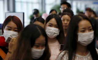 Passengers wear masks to prevent contracting Middle East Respiratory Syndrome at Incheon International Airport in Incheon, South Korea, June 2, 2015.  Photo by Kim Hong-Ji/Reuters