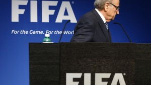 FIFA President Sepp Blatter leaves after his statement during a news conference at the FIFA headquarters in Zurich, Switzerland, June 2, 2015.  Blatter resigned as FIFA president on Tuesday, four days after being re-elected to a fifth term. Blatter, 79, announced the decision at a news conference in Zurich, six days after the FBI raided a hotel in Zurich and arrested several FIFA officials.     REUTERS/Ruben Sprich TPX IMAGES OF THE DAY - RTR4YJC0