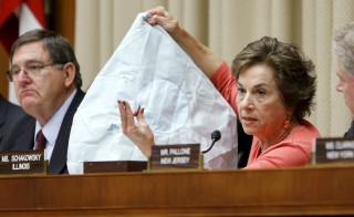 U.S. Representative Jan Schakowsky (D-IL) holds a defective air bag and shrapnel from its deployment during her opening remarks at a hearing of a House Energy and Commerce Subcommittee on the Takata airbag recall, on Capitol Hill in Washington June 2, 2015. Also pictured is subcommittee chairman Representative Michael Burgess (R-TX) (L). REUTERS/Jonathan Ernst - RTR4YJPQ