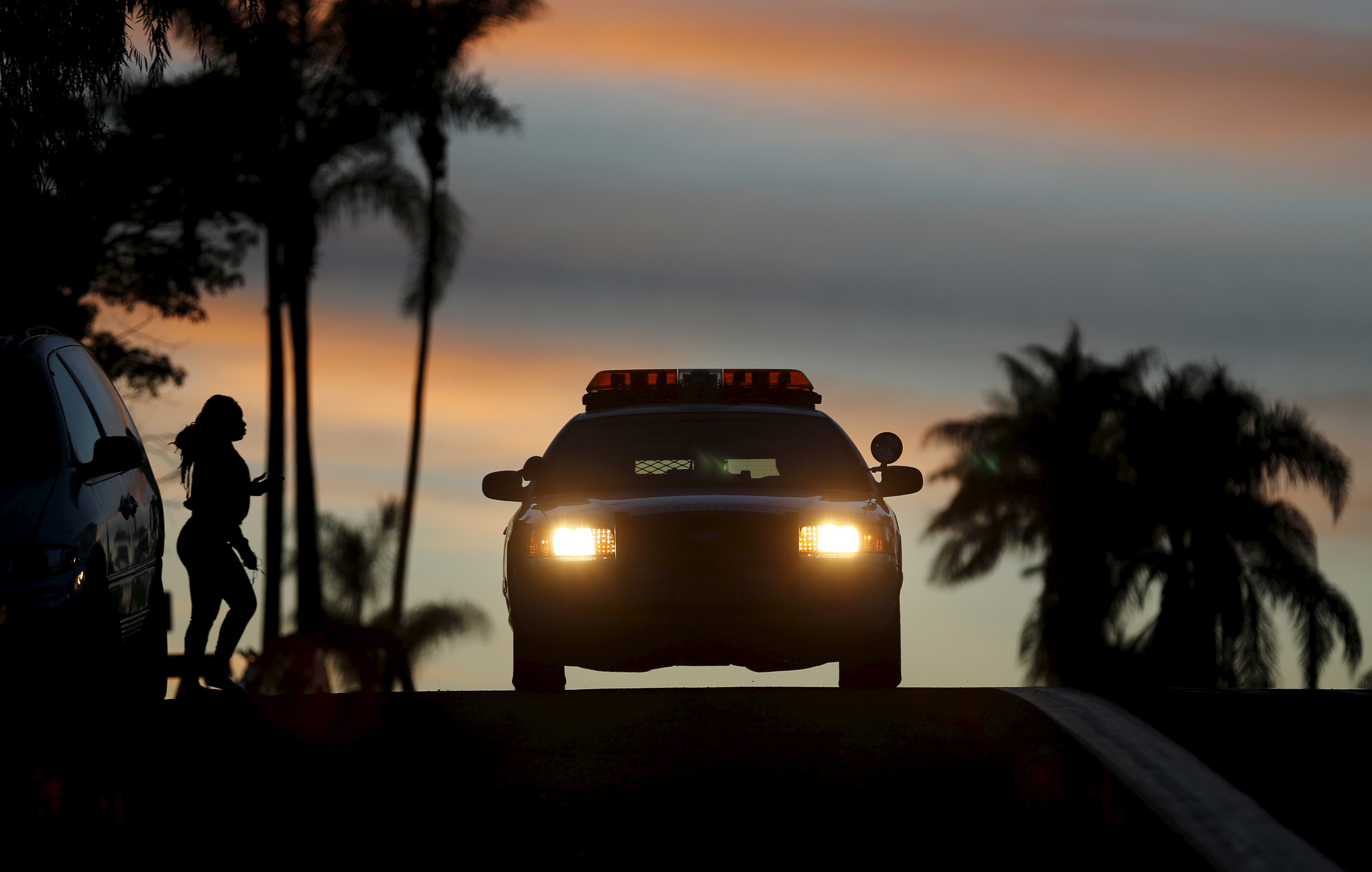 RSVP member Steve Rubin drives while on patrol with partner Henry Miller, March 10, 2015. Photo by Mike Blake/Reuters