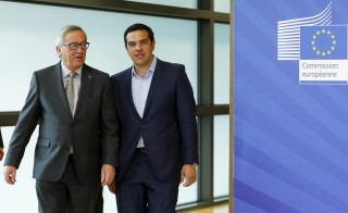 Greek Prime Minister Alexis Tsipras (right) walks with European Commission President Jean-Claude Juncker ahead of a meeting at the EU Commission headquarters in Brussels, Belgium, on June 3. Photo by Francois Lenoir/Reuters