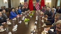 U.S. President Barack Obama (4th R) and members of his cabinet welcome Strategic and Economic Dialogue principals, including China's Vice Premier Wang Yang (2nd L, with earpiece), Vice Premier Liu Yandong (3rd L, in blue) and State Councilor Yang Jiechi (4th L) in the Cabinet Room at the White House in Washington June 24, 2015. REUTERS/Jonathan Ernst - RTR4YTA3