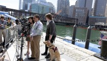 Marathon survivor Henry Borgard (right) pets his PTSD service dog named Friday as Scott Weisberg speaks to the media, after convicted Boston Marathon bomber Dzhokhar Tsarnaev was formally sentenced at the federal courthouse in Boston, Massachusetts June 24, 2015. Tsarnaev on Wednesday apologised for the deadly 2013 attack at a hearing before a U.S. judge formally sentenced him to death for killing four people and injuring 264 in the bombing and its aftermath. REUTERS/Dominick Reuter - RTR4YTLU