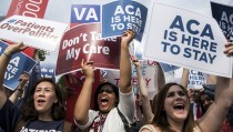 Supporters of the Affordable Care Act celebrate after the Supreme Court up held the law in the 6-3 vote at the Supreme Court in Washington June 25, 2015. The U.S. Supreme Court on Thursday upheld the nationwide availability of tax subsidies that are crucial to the implementation of President Barack Obama's signature healthcare law, handing a major victory to the president.  REUTERS/Joshua Roberts - RTR4YXBA